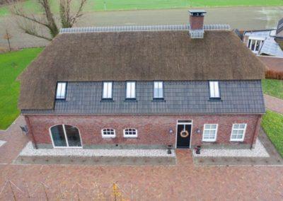 Nieuwbouw woonboerderij met garage